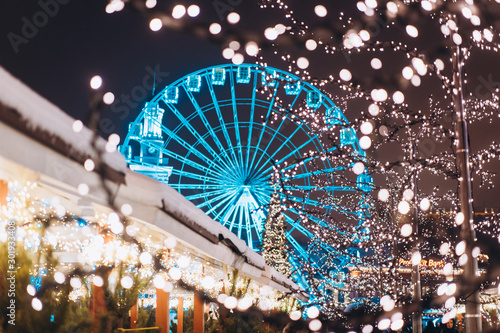 Christmas zone on Kontraktova Square with a Ferris wheel Canvas