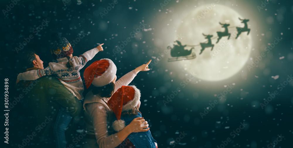 Fototapeta Family enjoying Christmas