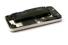 Swollen Lithium Ion Polymer Battery Inside A Mobile Phone On White Background Isolated