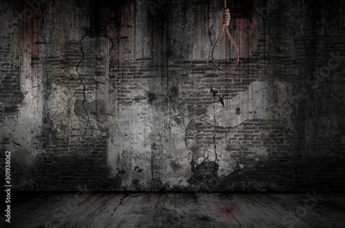 Spoed Fotobehang Baksteen muur Rope or noose used to hang people has stains and drops of blood are stuck with bloody background scary old bricks wall and floor, concept of murder and horror