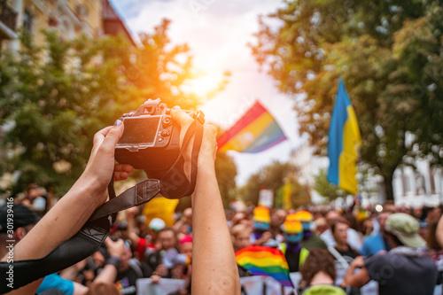 Correspondent takes photo during the Gay Pride parade Canvas Print