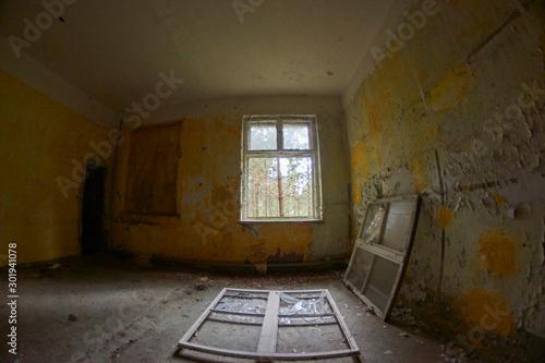 Photo  Window fallen on floor at communist abandoned soviet military base in east Germa