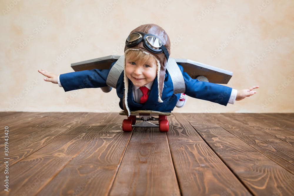 Fototapeta Portrait of young businessman with toy paper wings