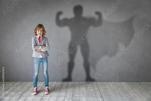 Fotografie, Obraz  Teenager dreams of becoming a superhero