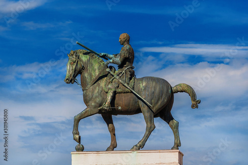 Gattamelata bronze equestrian statue among clouds, in the historic center of Pad Wallpaper Mural