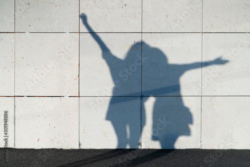 Fototapeta Unrecognizable couple having fun with her shadows obraz na płótnie
