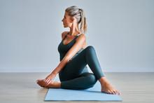 Adult Woman Practising Yoga At...