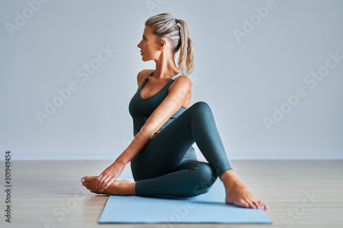 Recess Fitting Yoga school Adult woman practising yoga at home