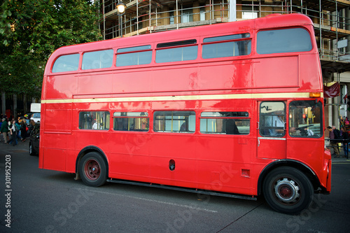 Fototapeta Classic red double-decker Routemaster bus passing on a London, UK street