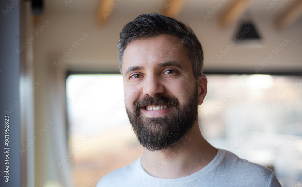 Fototapeta Mature man standing in house, moving in new home concept.