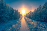Fototapeta  - Snowy winter railroad view. First snow sunset landscape. Photo from Sotkamo, Finland.