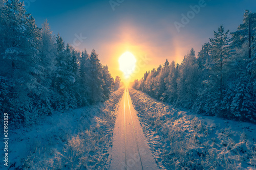 Fototapeta Snowy winter railroad view. First snow sunset landscape. Photo from Sotkamo, Finland. obraz