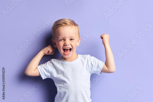 Fototapeta  Emotional little boy full of happy feelings