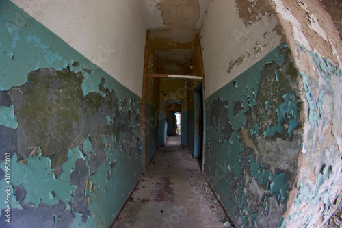 Abandoned places hallway with peeling lead paint  in Russian cold war secret Eas Wallpaper Mural