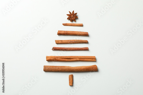 Fototapeta Christmas tree made of cinnamon on grey background, space for text obraz