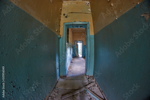 Abandoned places hallway with peeling lead paint  in Russian cold war secret Eas Canvas Print