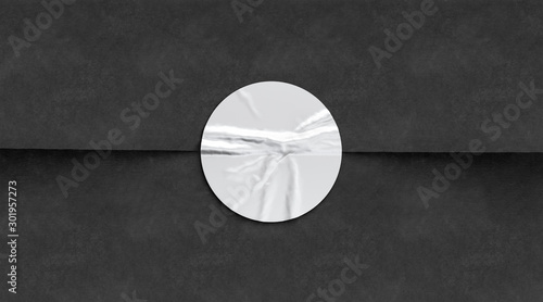 Photo BLank white crumpled sticker on black paper mockup