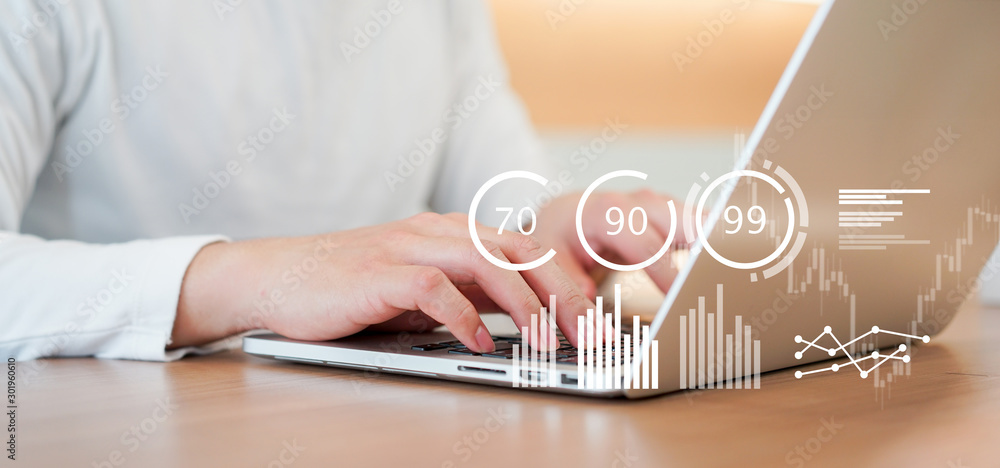 Fototapeta close up businessman typing on laptop to working about planning business strategy , forecasting financial exchange market with dashboard tools monitor for futuristic technology concept
