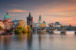 canvas print picture Prague, Czech Republic. Cityscape image of famous Charles Bridge in Prague during beautiful autumn sunset.