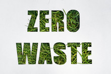 Zero Waste Paper Text With Green Grass On White Background. Lettering. Ecology Concept