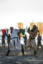 Festival And Celebration Of Moros Y Cristianos (Moors And Christians) In The Town Of El Campello, Alicante, Spain. Two Men In Costume Are Fighting.