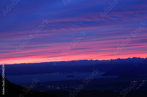 BEAUTIFUL SUNSET OVER THE LAKE FROM TOP OF THE MOUNTAIN Wallpaper Mural