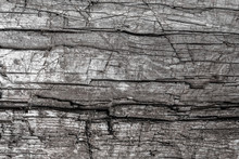 Texture Of A Wooden Board Dry And Old Covered With Cracks And Scratches