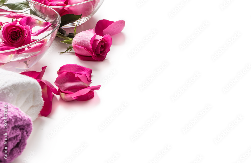 Fototapety, obrazy: Pink roses petals in bowl with towels and pure water over white.. Spa and wellness concept