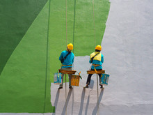 Two Painters Are Painting The ...