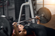 Close View Of Charming A Sporty Woman In Good Shape Lying On Bench In Modern Fitness Studio Trying To Start Exercise With Heavy Barbell, Preparing For Competition Of Bodybuilders