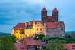 Leinwanddruck Bild Quedlinburg Castle over old town in the evening, Germany