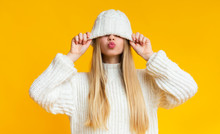 Girl With Kissing Lips Pulling Down Woollen Hat