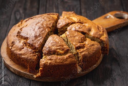 Foto auf Leinwand Brot Homemade banana cake with apples and walnuts.