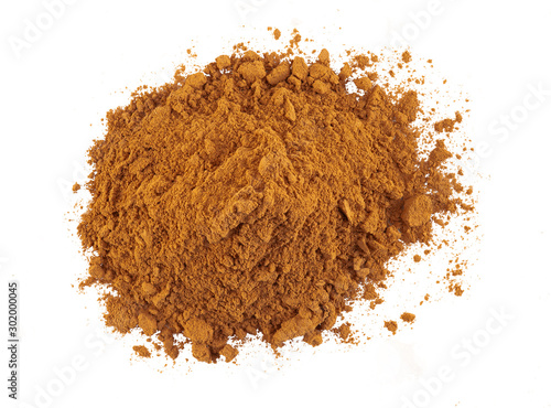 Fototapeta Ground cinnamon isolated on white background. As spice, condiment sold in the form of sticks or powder. Packaging concept. Close-up, top view. obraz