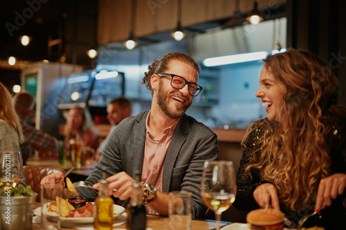 Best friends sitting in restaurant for dinner, drinking wine and chatting Fototapete