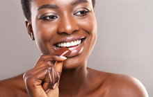 Beautiful Afro Woman Biting Of...
