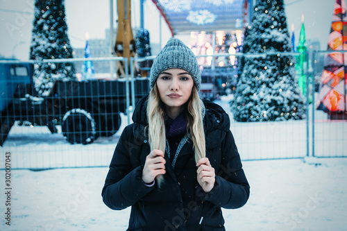 photo with grain and aberrations under the old photo, film photo beautiful girl in a hat with coffee in the evening, basks, near the Christmas tree, winter holidays, holiday and walks Wallpaper Mural