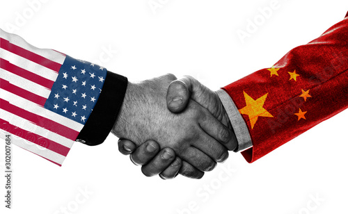 Photo .Print screen of USA and China flag on shirts of businessman hand shaking.It is