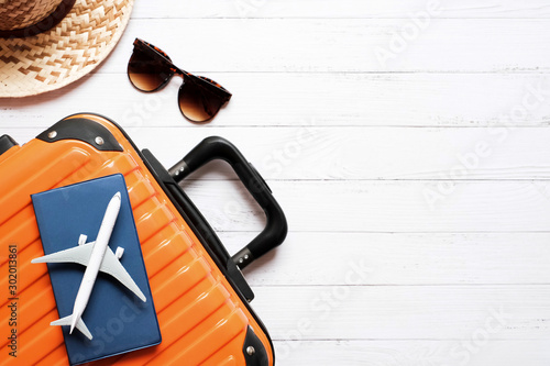 Fotomural  Flat lay planing and travel concept on white wooden table background with plane
