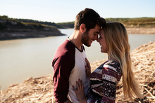 Loving Couple Hugging On River...