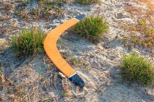 Australian boomerang lies on the sandy ground Canvas Print