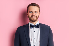 Young Beautiful Man Look At Camera With Smile On Face, Natural Expression. Laughing Confident Fiance Before Wedding. Pink Background