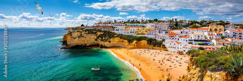 View of Carvoeiro fishing village with beautiful beach, Algarve, Portugal. View of beach in Carvoeiro town with colorful houses on coast of Portugal. The village Carvoeiro in the Algarve Portugal.