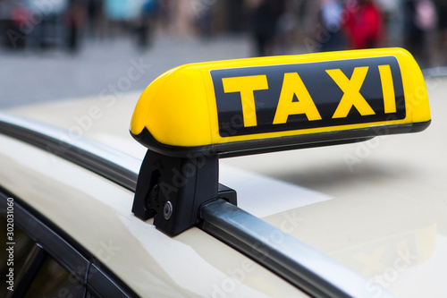 Fotografering Close-up of a Taxi Sign