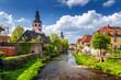 Leinwandbild Motiv Cityscape by the river Alb in Ettlingen, Black Forest, Baden-Wurttemberg, Germany, Europe