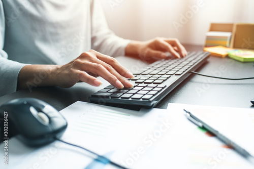 Obraz Business woman hand with computer mouse and keyboard on table at office - fototapety do salonu