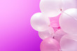 canvas print picture - Bright colorful balloons on a pink background. Pink balloons. The concept of a happy birthday or honeymoon.