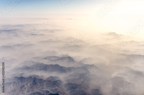 Aerial landscape mountain lost in thick fog in China in the morning sunlight, bi Fototapete