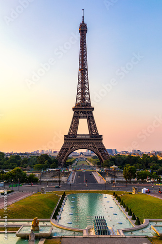 Obraz Eiffel tower in summer, Paris, France. Scenic panorama of the Eiffel tower under the blue sky. View of the Eiffel Tower in Paris, France in a beautiful summer day. Paris, France. - fototapety do salonu