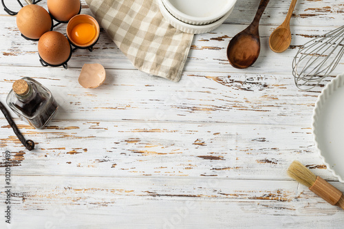 Valokuvatapetti Baking pastry background frame, ingredients, kitchen utensils on rustic wooden b